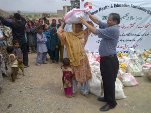 Chairman CHAEF distributing dry ration at Moladad Goth